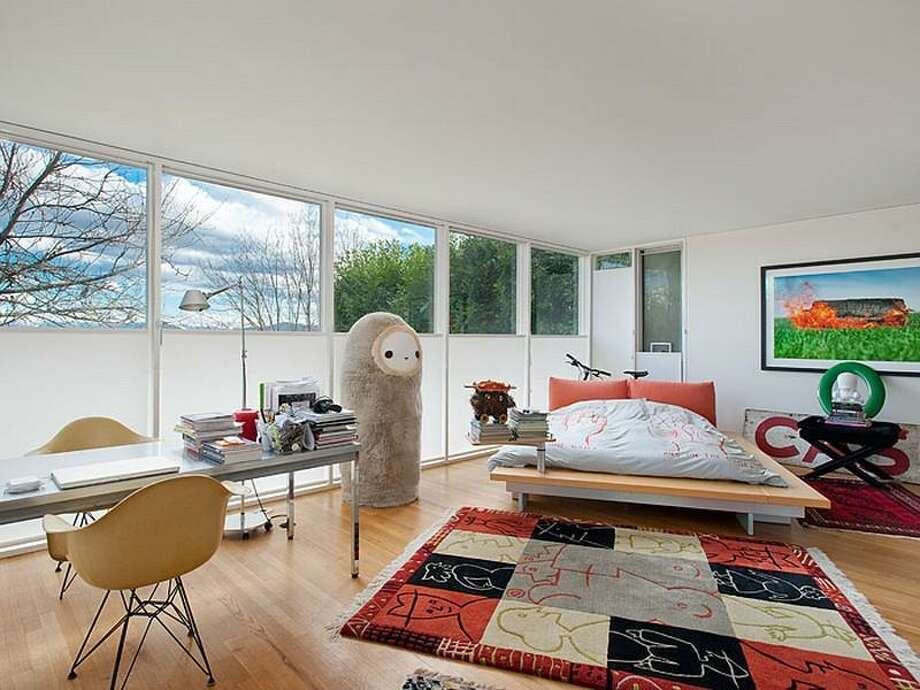 Bedroom of 700 37th Ave. The 2,220-square-foot house, built in 1977, has two bedrooms, two three-quarter bathrooms, a lower-level rec room, walls of windows, a skylight, built-ins, a big deck and unobstructable views of Lake Washington, Bellevue and the Cascade Mountains. It's listed for $995,000. Photo: Courtesy Moira Holley And Scott Wasner/Realogics Sotheby's International Realty