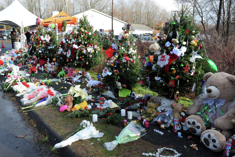 Twenty eight Christmas trees have been set up and decorated near the entrance to Sandy Hook Elementary School, in Newtown, Conn., Dec. 18th, 2012. Photo: Ned Gerard / Connecticut Post