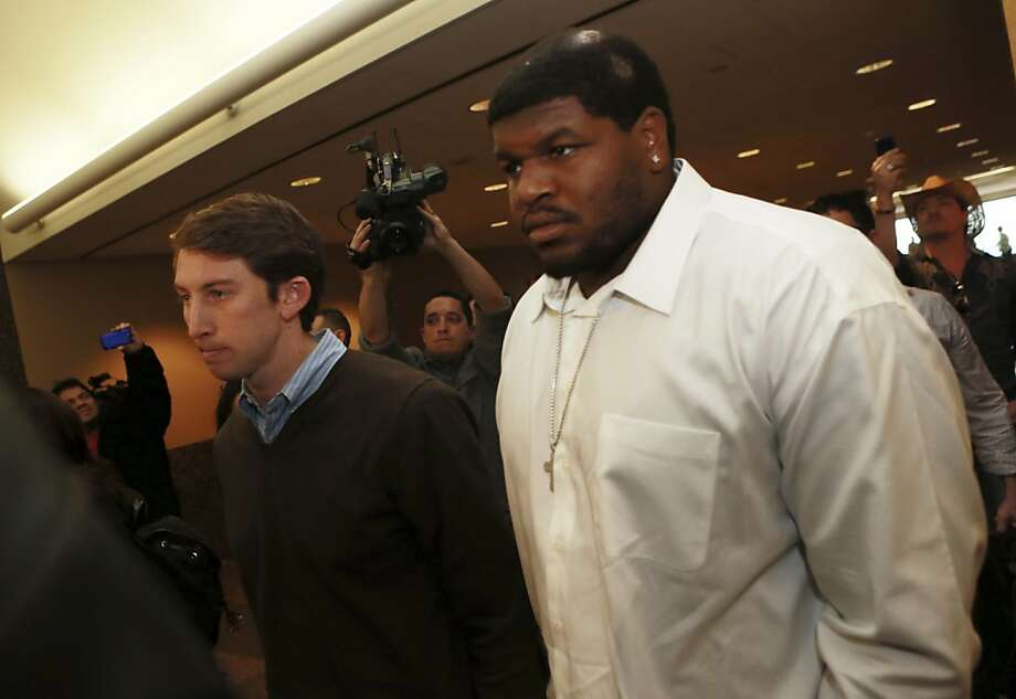 Josh Brent (right), charged with intoxication manslaughter, must wear an alcohol monitor, but had his bond reduced. Photo: Michael Mulvey, Associated Press