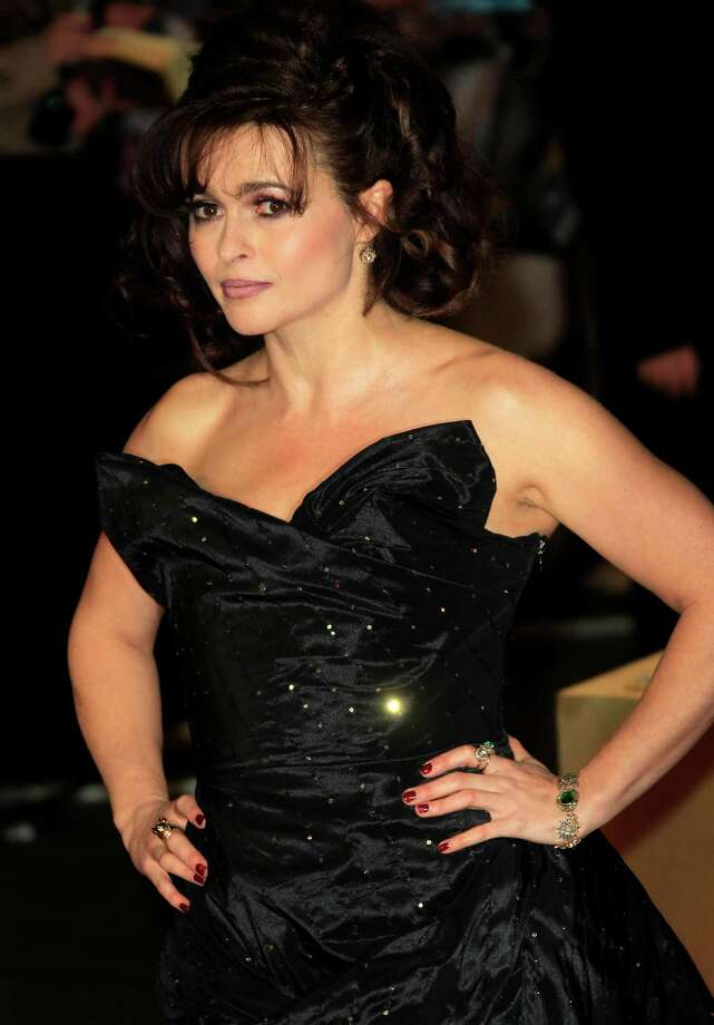 "FILE - In this Wednesday, Dec. 5, 2012 file photo, Helena Bonham Carter arrives on the red carpet for the World Premiere of ""Les Miserables"" at a central London cinema in Leicester Square.  A report from Ancestry.com says Victor Hugo was a political colleague of a cousin of the 46-year-old actress. Carter stars as Madame Thenardier in the upcoming musical ""Les Miserables."" (Photo by Joel Ryan/Invision/AP, File) Photo: Joel Ryan"