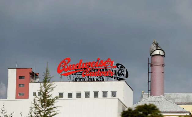 In this Tuesday, Oct. 30, 2012 photo a view of the Budejovicky Budvar brewery, in Ceske Budejovice, Czech Republic. They've been arguing about a name for 106 years. A small brewer in the Czech Republic and the world's biggest beer maker have been suing each other over the right to put the word Budweiser on their bottles in what has become a David versus Goliath corporate saga. A deal, it seems, will have to wait a bit longer because settlement talks between state-owned Budejovicky Budvar and Anheuser-Busch, a U.S. company now part of AB InBev, have collapsed, according to Budvar's director general, Jiri Bocek. (AP Photo/Petr David Josek) Photo: Petr David Josek