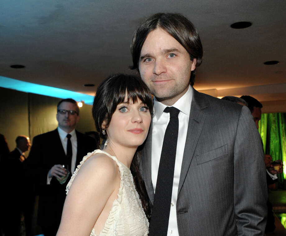 FILE - In this Jan. 16, 2011 file photo, actress Zooey Deschanel, left, and her husband, singer Ben Gibbard attend the 2011 HBO Golden Globe Party in Beverly Hills, Calif. Court records show a Los Angeles judge finalized the former couple's divorce on Wednesday Dec. 12, 2012. The pair were married in 2009 and separated in October 2011. (AP Photo/Dan Steinberg, file) Photo: Dan Steinberg