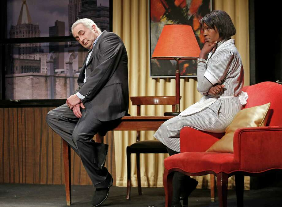 """FILE - In this Nov.15, 2012 file photo, French actor Eric Debrosse acting as former International Monetary Fund leader Dominique Strauss-Kahn, left, and actress Jelle Saminnadin acting as Nafissatou Diallo, the hotel housekeeper, who accused Dominique Strauss-Kahn of sexually assaulting her, pose during a photo opportunity as they perform in a play """"Suite 2806"""" in a Paris theatre. One-time French presidential hopeful Dominique Strauss Kahn has been to hell and back since he was charged, then acquitted in New York of  making a hotel maid perform a sexual act in 2011. Now DSK will be treading the boards, in a salacious new play that recounts knock for knock what might have happened in the now infamous suite of the Manhattan Sofitel hotel. (AP Photo/Christophe Ena, File) Photo: Christophe Ena"""