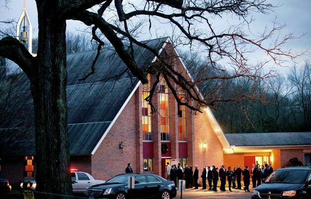 Mourners gather for the wake for Sandy Hook Elementary School shooting victim Charlotte Helen Bacon, 6, at Christ the King Lutheran Church, Tuesday, Dec. 18, 2012, in Newtown, Conn. A gunman walked into Sandy Hook Elementary School in Newtown Friday and opened fire, killing 26 people, including 20 children. (AP Photo/David Goldman) Photo: David Goldman, ASSOCIATED PRESS / AP2012