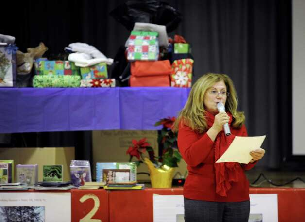 New Lebanon School Principal Barbara Rucci on Tuesday, Dec. 18, 2012, at New Lebanon in Byram, Conn, spoke of the gifts the children helped to get for the PS 104 school in Rockaway Queens, N.Y., which was hit hard by Hurricane Sandy. New Lebanon School welcomed the principal and some staff from PS 104 in Rockaway Queens, N.Y., to whom they gave gifts, gift cards, school items like T-shirts for students and staff. Photo: Helen Neafsey / Greenwich Time
