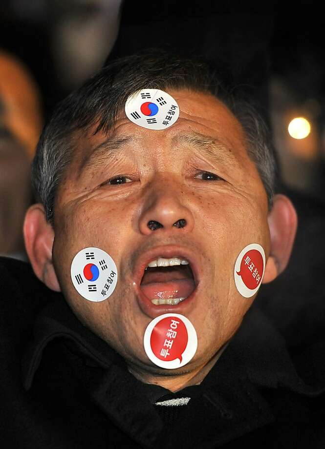 A supporter of South Korea's presidential candidate Park Geun-Hye of the ruling New Frontier Party shouts during her election campaign in Seoul on December 18, 2012. The two rivals for South Korea's presidency made a final pitch to voters on the eve of an election that looks set to go down to the wire and could produce the country's first female leader.  AFP PHOTO / JUNG YEON-JEJUNG YEON-JE/AFP/Getty Images Photo: Jung Yeon-je, AFP/Getty Images