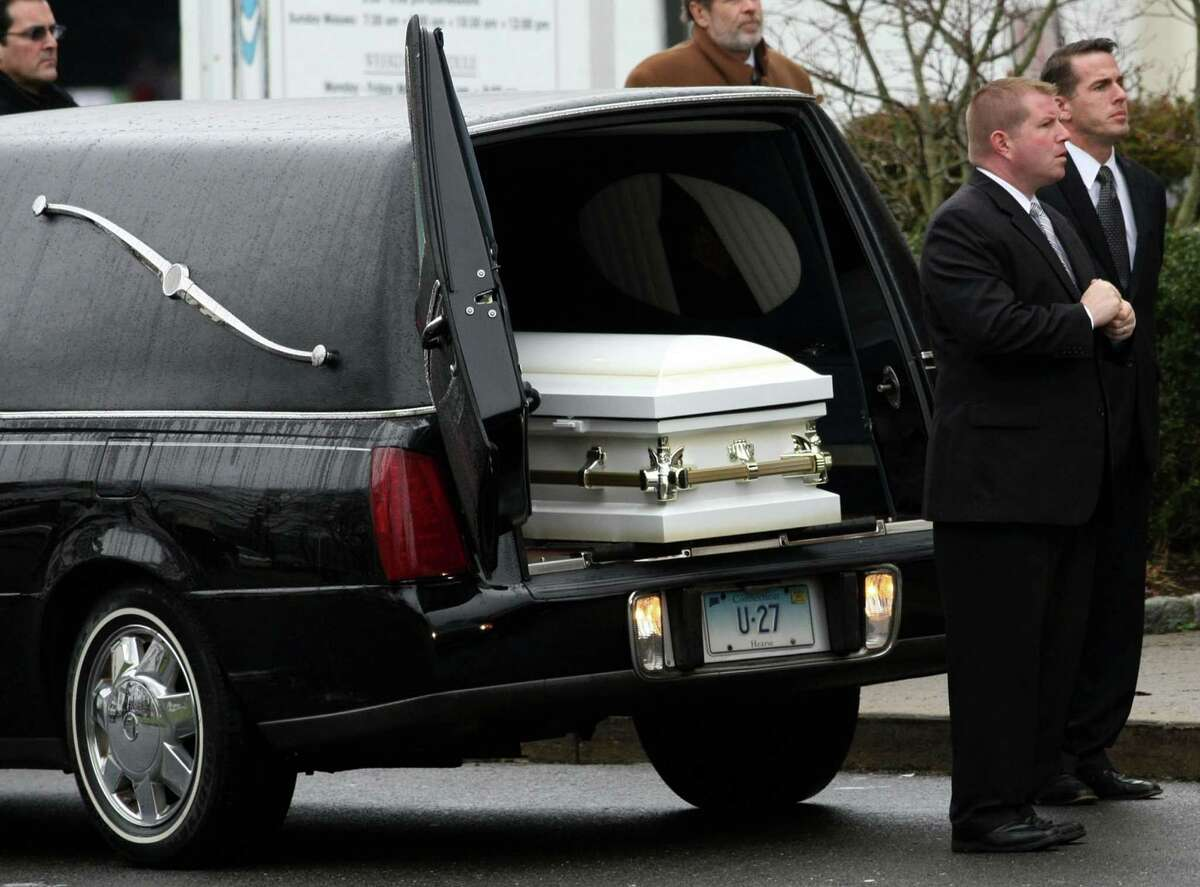 The casket carrying the body of Sandy Hook Elementary School student Jessica Rekos, 6, waits to be carried into the St. Rose of Lima Church for funeral services in Newtown, Connecticut, Tuesday, December 18, 2012. (Genaro Molina/Los Angeles Times/MCT)