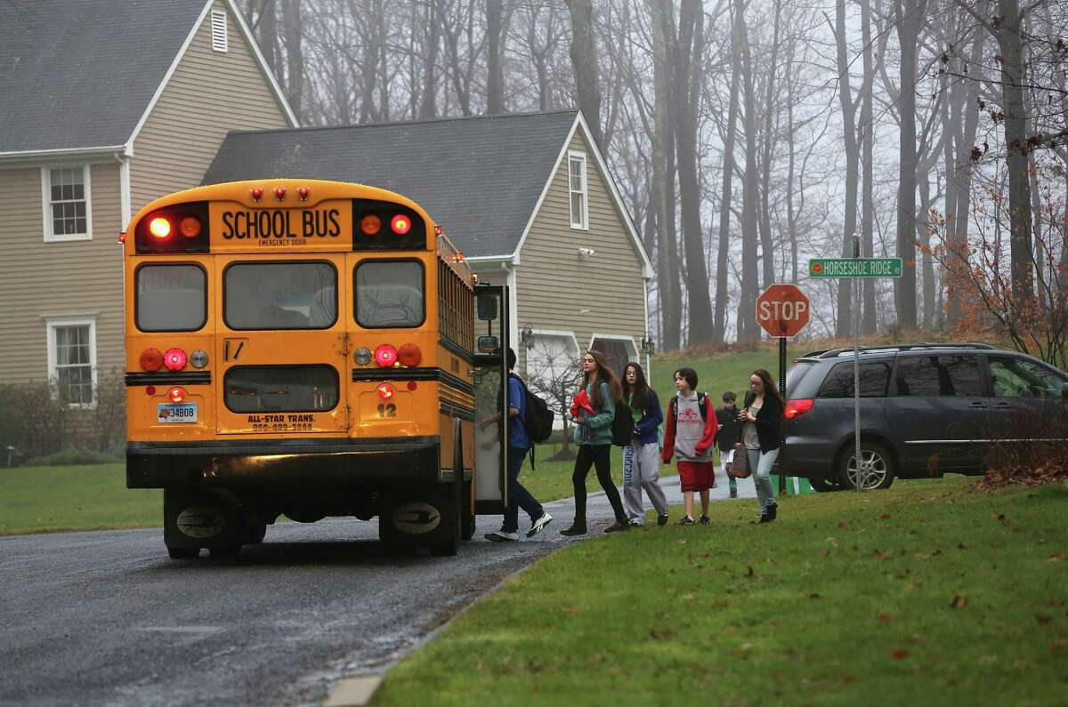 NEWTOWN, CT - DECEMBER 18: Children return to school on December 18, 2012 in Newtown, Connecticut. Four days after 20 children and six adults were killed at Sandy Hook Elementary School, most students in Newtown returned to school. Children at Sandy Hook Elementary will attend a school in a neighboring town until authorities decide whether or not to reopen Sandy Hook. (Photo by John Moore/Getty Images)