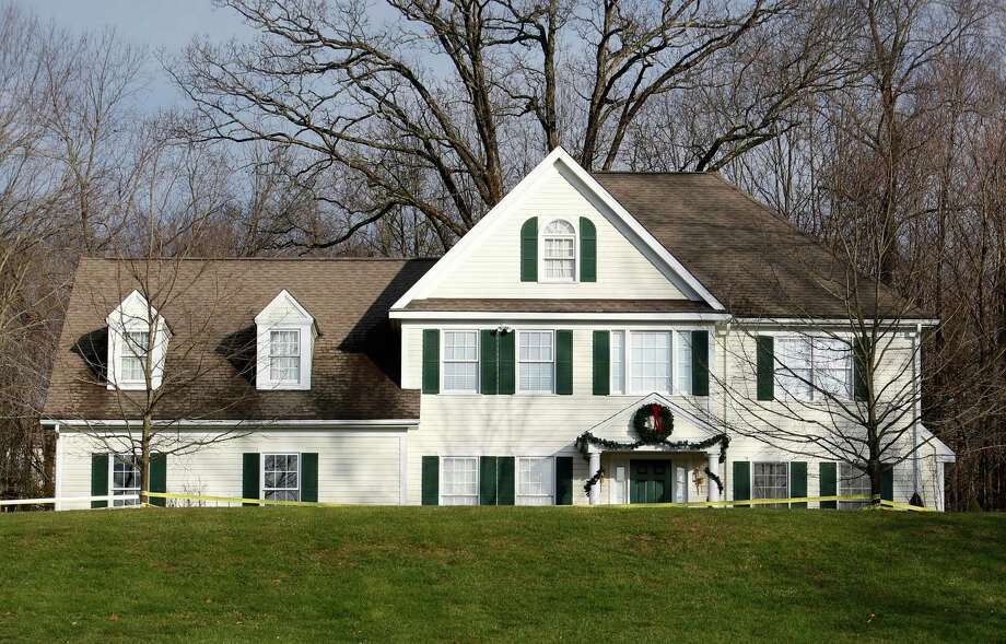 Crime scene tape surrounds the home of Nancy Lanza, Tuesday, Dec. 18, 2012, in Newtown, Conn.  Nancy Lanza was killed by her son Adam Lanza before he forced his way into Sandy Hook Elementary School in Newtown Friday and opened fire, killing many others, including 20 children. Photo: Jason DeCrow, AP Photo/Jason DeCrow / AP2012 Associated Press