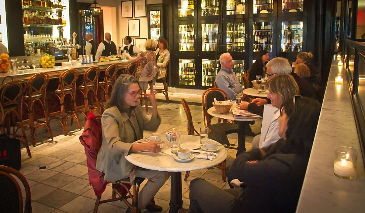 Customers enjoy happy hour at Cafe Des Amis in San Francisco, Calif., is seen on Tuesday, November 1, 2011.