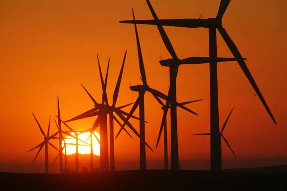 A sunrise view is seen at EDF Renewable field of gigantic wind turbines, which stand nearly 300 feet high near Rio Vista, California, September 24, 2012. (Bob Chamberlin/Los Angeles Times/MCT)