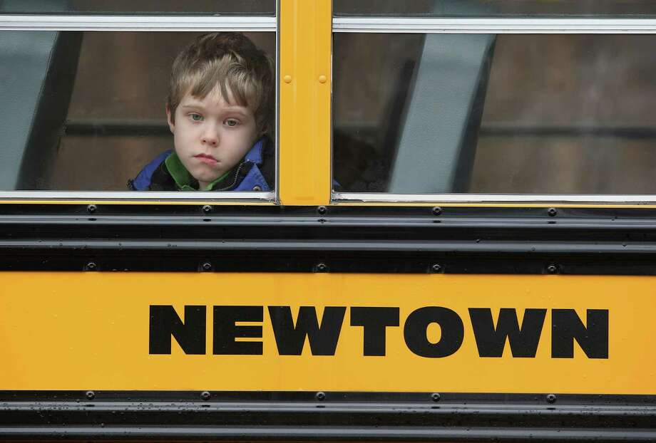 Most students in Newtown returned to school Tuesday. Children at Sandy Hook Elementary will attend a school in a neighboring town until authorities decide whether or not to reopen their school. Photo: John Moore, Staff / 2012 Getty Images