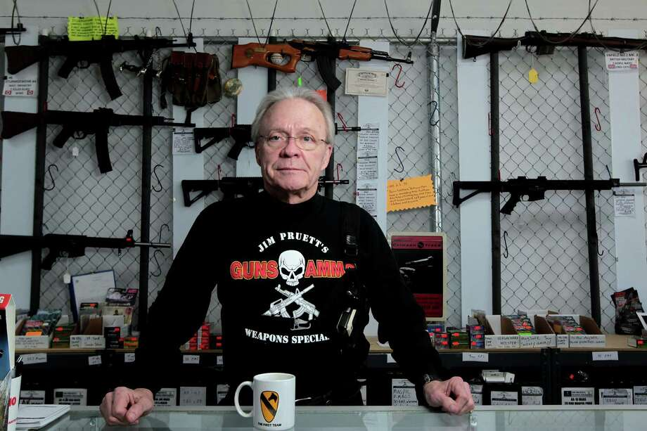 Jim Pruett, owner of Jim Pruett's Guns & Ammo, supports Dick's Sporting Goods' move, but says restricting the sales of military-style arms won't prevent tragedies like the one in Newtown, Conn. Photo: James Nielsen, Chronicle / © Houston Chronicle 2012
