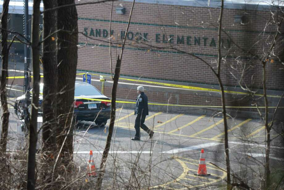 Scene outside Sandy Hook Elementary School Saturday morning Dec. 15, 2012, in Sandy Hook, Conn., where 20 children and six teacehrs were killed by a lone 20-year-old gunman Friday. (Will Waldron / Times Union) Photo: Will Waldron