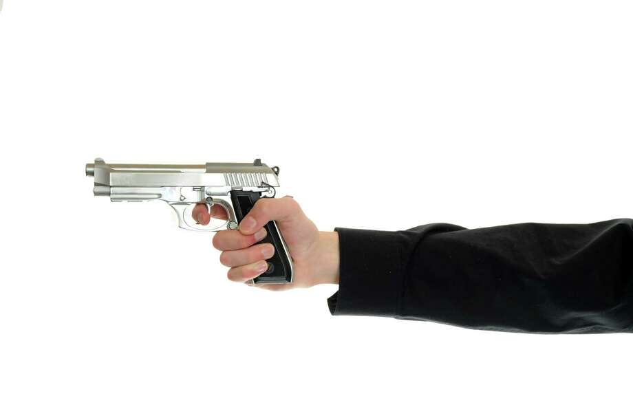 The right to bare arms. White hand holds firearm isolated on white background. / vlorzor - Fotolia