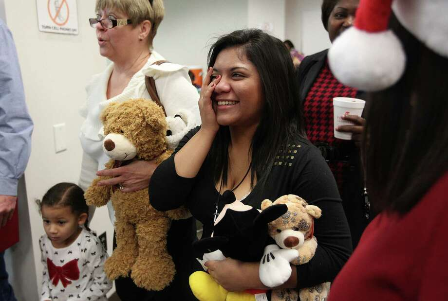 """I always felt they (the Ivey Family) were my home"" says Desiree Ivey, 16, as she holds back tears after her adoption ceremony at the Juvenile Justice Center on Tuesday, Dec. 18, 2012, in Houston. Over 90 CPS children, ages 1-17, have found their ""forever home"" for Christmas, and were part of a mass adoption celebration. Photo: Mayra Beltran, Houston Chronicle / © 2012 Houston Chronicle"