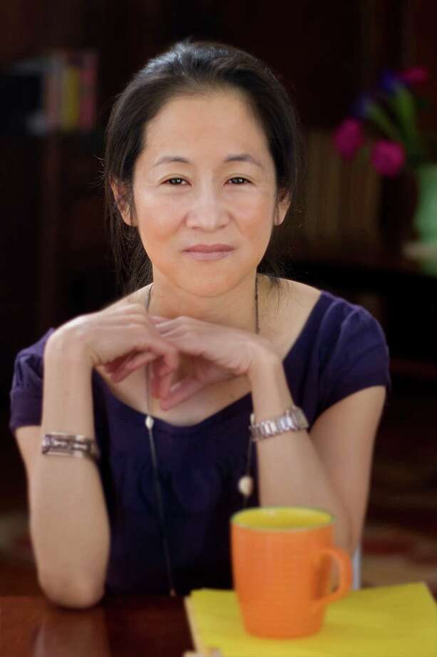 "Julie Otsuka, author of ""When the Emperor was Divine,"" was chosen as the Greenwich Reads Together 2013 selection. Photo by Robert Bessoir Photo: Contributed Photo"