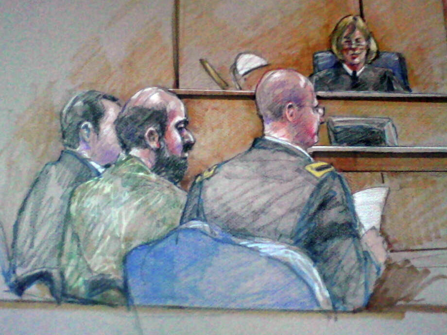 "Maj. Nidal Hasan, center foreground, will be allowed to keep his beard during his military trial. Col. Tara Abbey Osborn. presiding in the case, warned him that ""some people on the panel may hold that against  you."" Photo: Brigitte Woosley, FRE / AP"