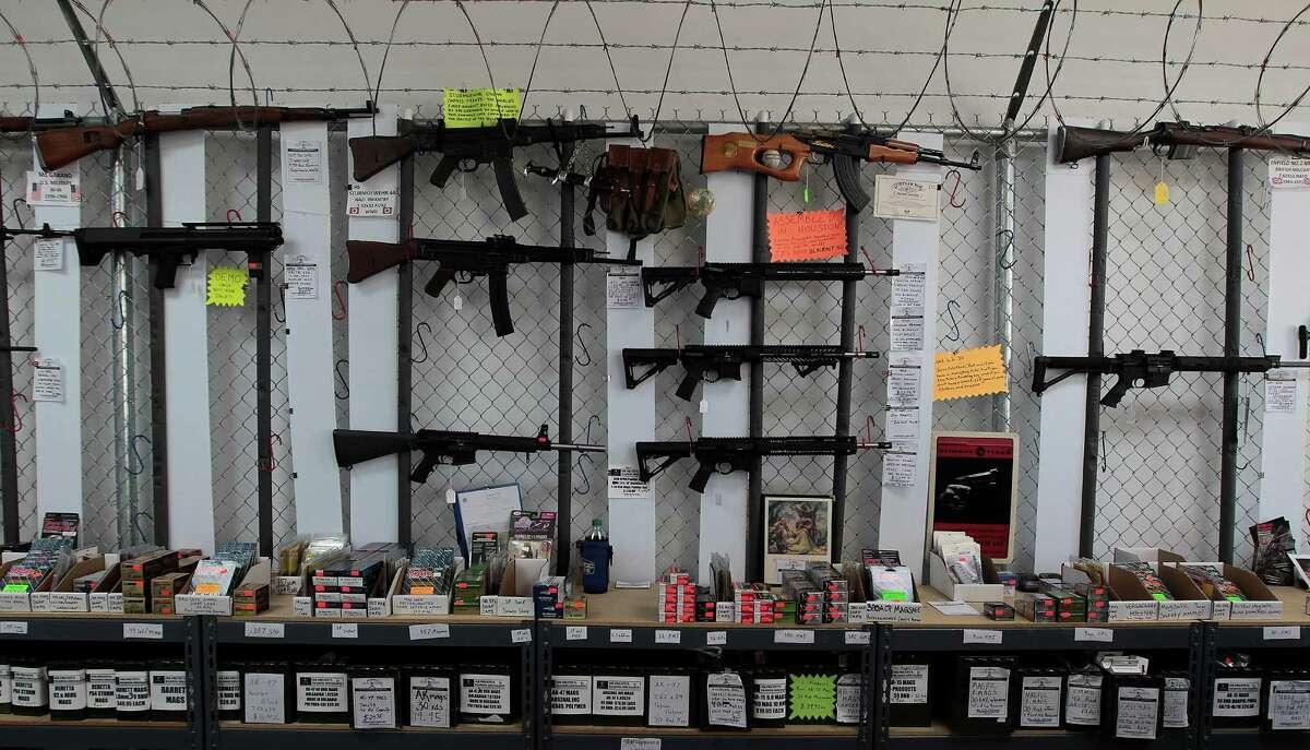 Assault-type weapons are on display at Jim Pruett Guns & Ammo, 10490 Huffmeister, in northwest Houston.