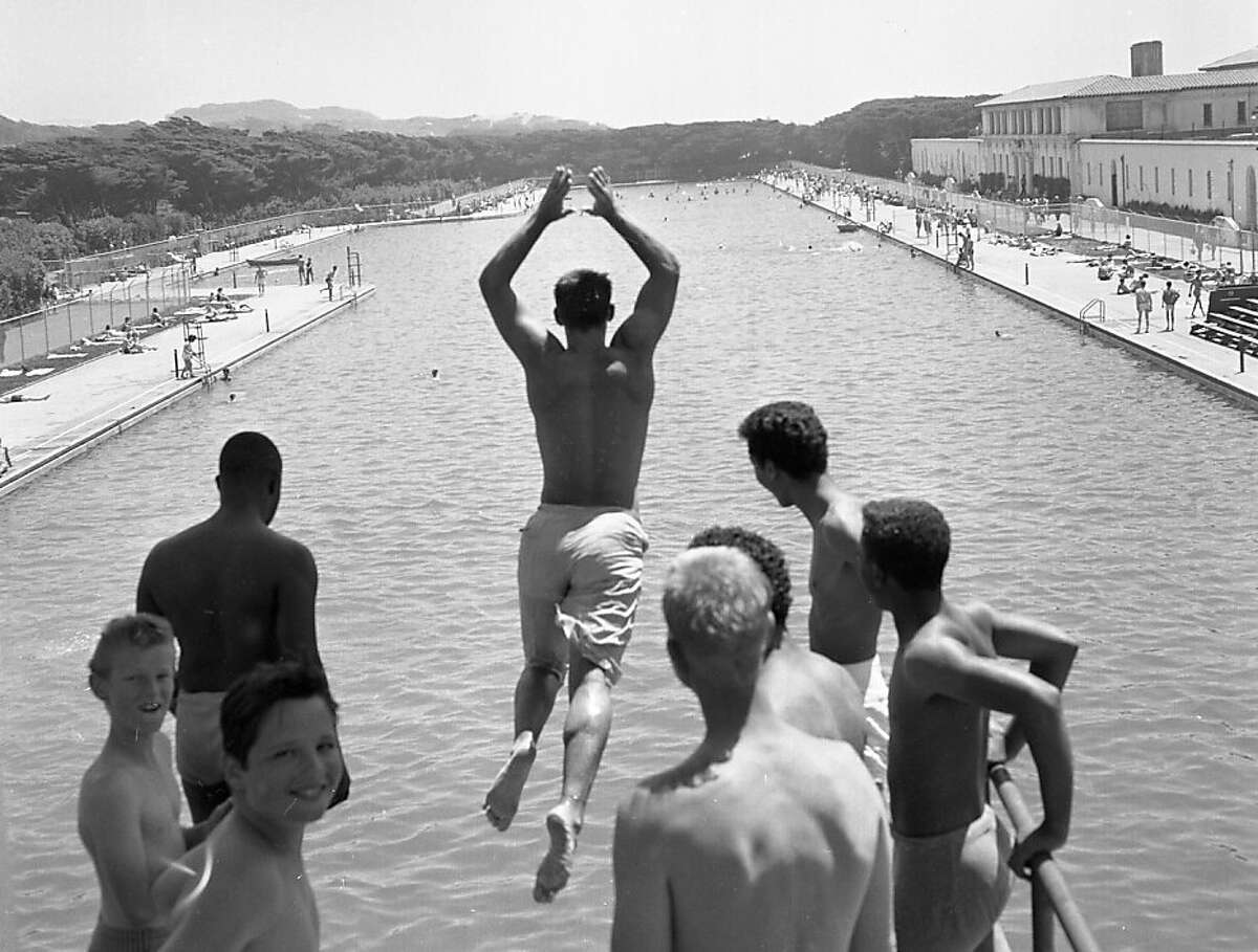July 5, 1961: Fleishhacker Pool thrived until the early 1960s. These kids are jumping off the high diving platform. Note the pool house on the right. (Chronicle file)