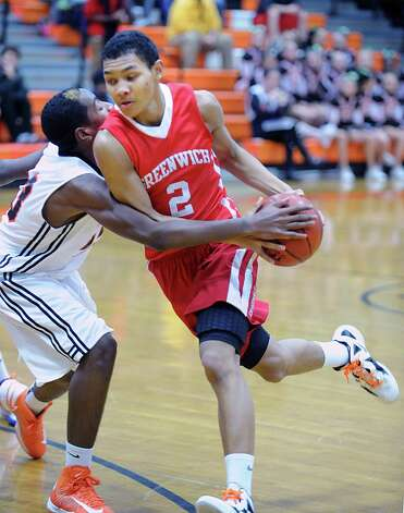 CJ Byrd (#2) of Greenwich drives to the hoop during the boys high school basketball game between Greenwich High School and Stamford High School at Stamford, Tuesday night, Dec. 18, 2012. Greenwich beat Stamford, 46-44. Photo: Bob Luckey / Greenwich Time