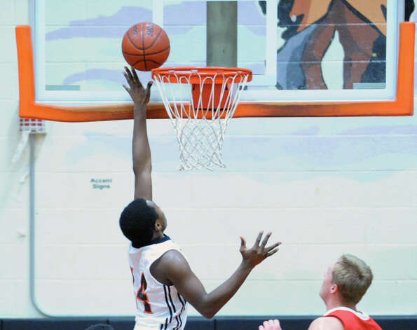 Kenny Wright of Stamford scores a layup during the boys high school basketball game between Greenwich High School and Stamford High School at Stamford, Tuesday night, Dec. 18, 2012. Greenwich beat Stamford, 46-44. Photo: Bob Luckey / Greenwich Time