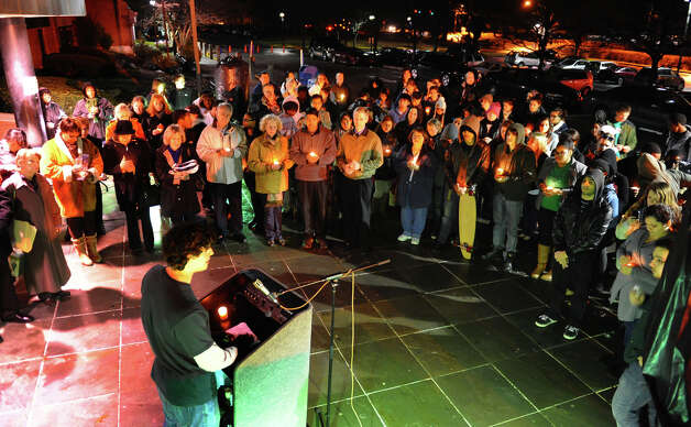 A candlelight vigil was held to remember the Newtown massacre victims at Norwalk Community College in Norwalk, Conn. on Tuesday December 18, 2012. Speaking at the podium is NCC's Student Body President Ben Engel. Photo: Christian Abraham / Connecticut Post