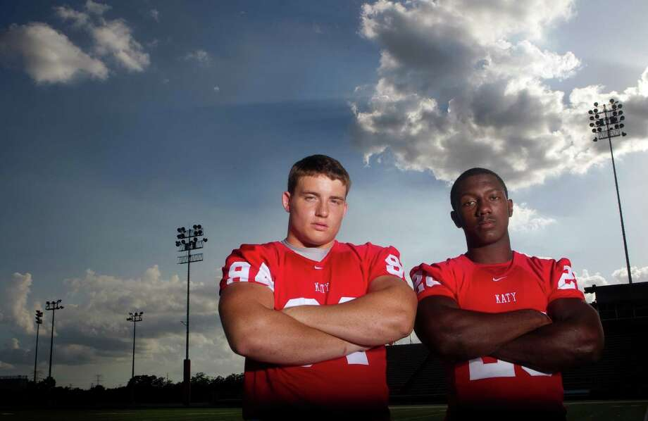 Defensive end Matt Dimon, left, and running back Adam Taylor helped anchor both sides of the ball for a Katy team that won the Class 5A Division II championship. Photo: Cody Duty, Staff / © 2011 Houston Chronicle