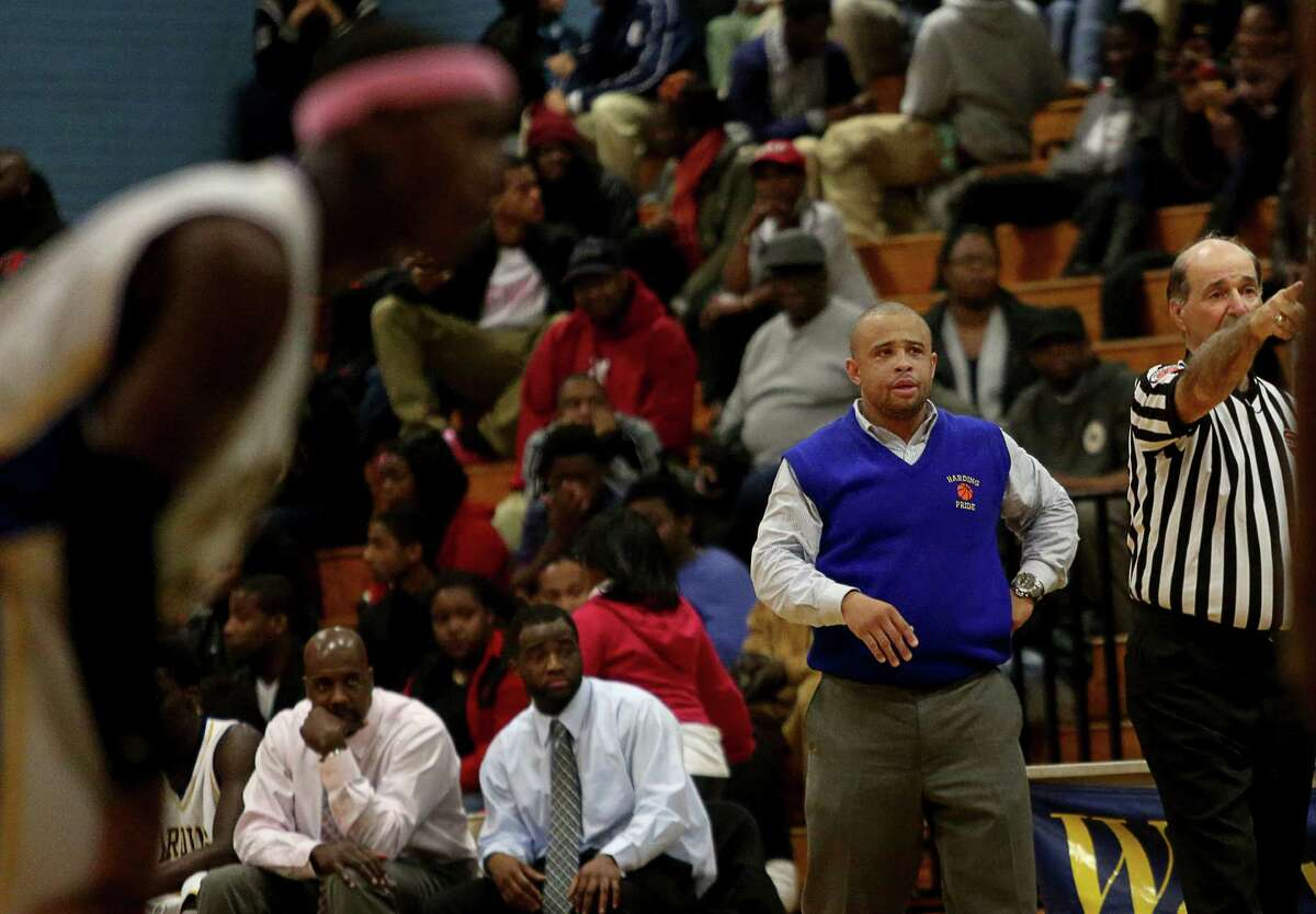 Mike Ross Connecticut Post freelance -Harding High School's coach Charles Clemons works the sidelines during Tuesday evening match-up against Trinity Catholic.