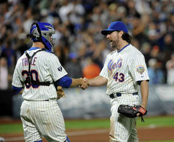 FILE -- New York Mets starting pitcher R.A. Dickey (43) reacts after winning a game against the Baltimore Orioles in New York, June 18, 2012. The Mets reached a deal to send Dickey to the Toronto Blue Jays for a package including the highly regarded young catcher Travis d'Arnaud and a top pitching prospect, Noah Syndergaard. (Barton Silverman/The New York Times) Photo: BARTON SILVERMAN / NYTNS