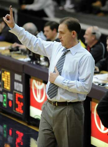 UAlbany Head Coach Will Brown signals to his team during a basketball game against Wagner at the SEFCU Arena Monday, Nov. 26, 2012 in Albany, N.Y. Rowley is fouled by Wagner's Orlando Parker on this play. (Lori Van Buren / Times Union) Photo: Lori Van Buren / 00020103A