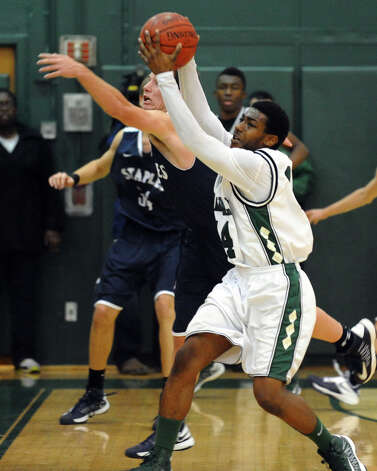 Norwalk's #14 Jabari Dear grabs a pass, during boys basketball action against Staples in Norwalk, Conn. on Tuesday December 18, 2012. Photo: Christian Abraham