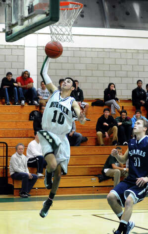 Norwalk's #10 Nick Boccanfuso attempts a lay up, during boys basketball action against Staples in Norwalk, Conn. on Tuesday December 18, 2012. Photo: Christian Abraham / Connecticut Post