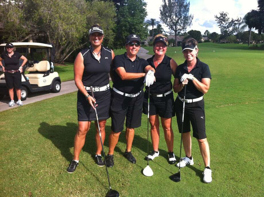 The Houston chapter of the Executive Women's Golf Association flexed its muscles in October by winning the EWGA National Scramble Championship with a team that included, from left, Robin Famiglietti, current Houston chapter president Cay Dickson, Stephanie Flower and Lynne Hoyt. Photo: Handout