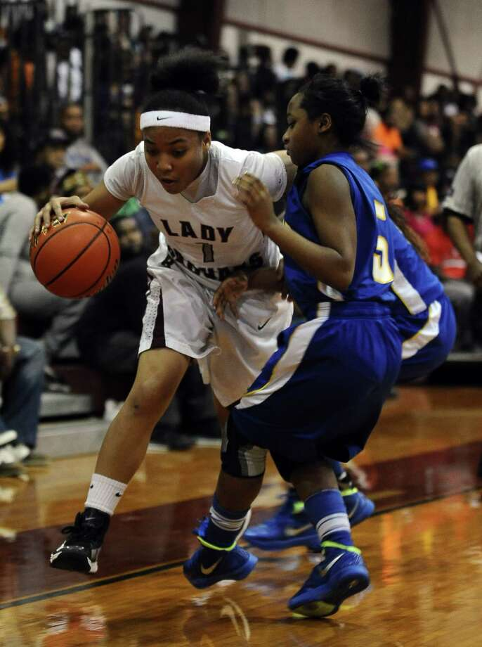 Lady Jaguar Malena Washington, #1, charges to the goal during the Central High School Lady Jaguars basketball game against the Ozen High School Lady Panthers on Tuesday December 18, 2012, at Central High School. Ozen won over Central 63 - 44. Photo taken: Randy Edwards/The Enterprise Photo: Randy Edwards