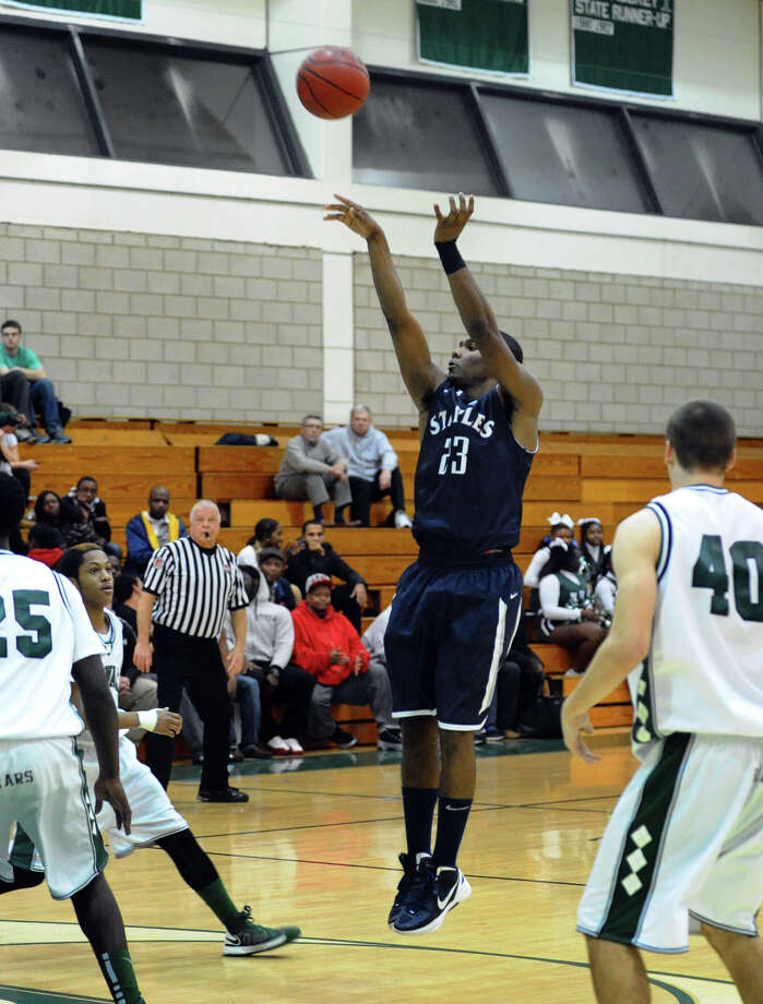Staples #23 Darryle Wiggins releases a shot during boys basketball action against Norwalk in Norwalk, Conn. on Tuesday December 18, 2012. Photo: Christian Abraham / Connecticut Post