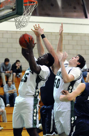 Norwalk's #25 Saeed Soulamane tries for a basket, during boys basketball action against Staples in Norwalk, Conn. on Tuesday December 18, 2012. Photo: Christian Abraham / Connecticut Post