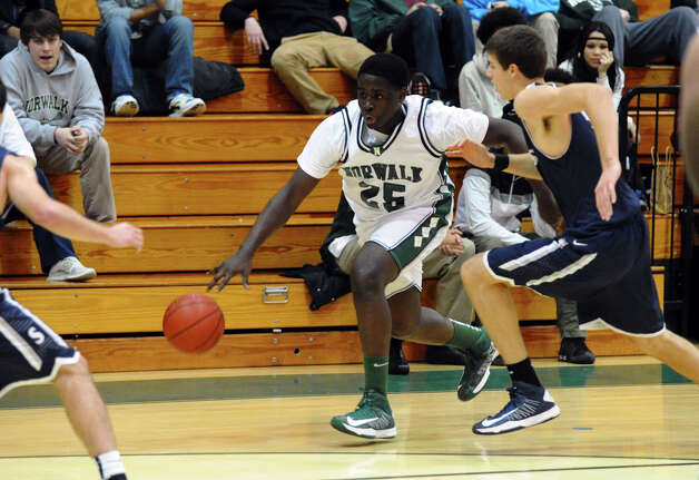 Norwalk's #25 Saeed Soulamane drives towards the basket, during boys basketball action against Staples in Norwalk, Conn. on Tuesday December 18, 2012. Photo: Christian Abraham / Connecticut Post