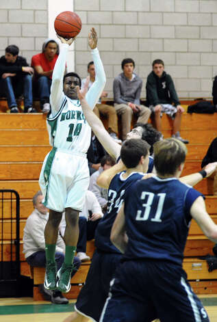 Norwalk's #14 Jabari Dear attempts a three pointer, during boys basketball action against Staples in Norwalk, Conn. on Tuesday December 18, 2012. Photo: Christian Abraham / Connecticut Post