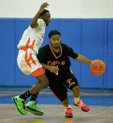 Danbury High School's CJ White tries to block Bridgeport Central High School's Jahdeh Summerville in a game at Danbury. Tuesday, Dec. 18, 2012 Photo: Scott Mullin / The News-Times Freelance