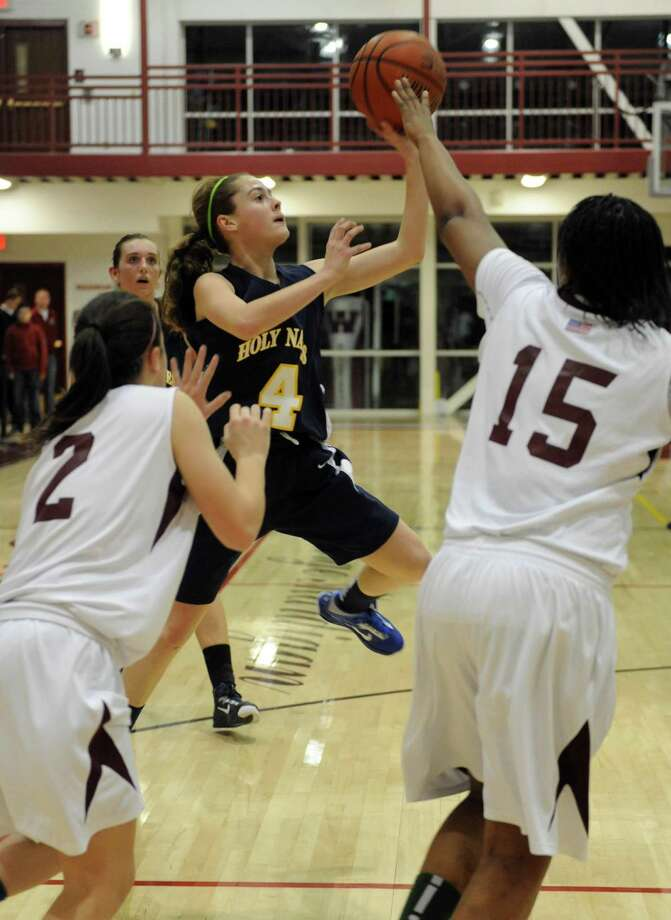 Holy Names Julia Smith takes a shot during their girl's high school basketball game against Watervliet in Watervliet, NY Tuesday Dec. 18, 2012. (Michael P. Farrell/Times Union) Photo: Michael P. Farrell