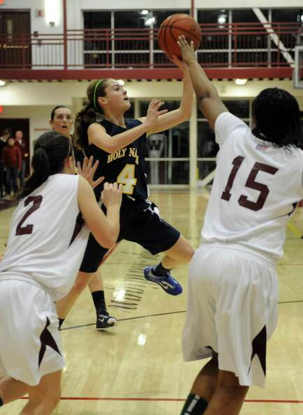 Holy Names Julia Smith takes a shot during their girl's high school basketball game against Watervli