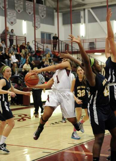 Watervliet's Ailayia Demand takes a shot during their girl's high school basketball game against Hol