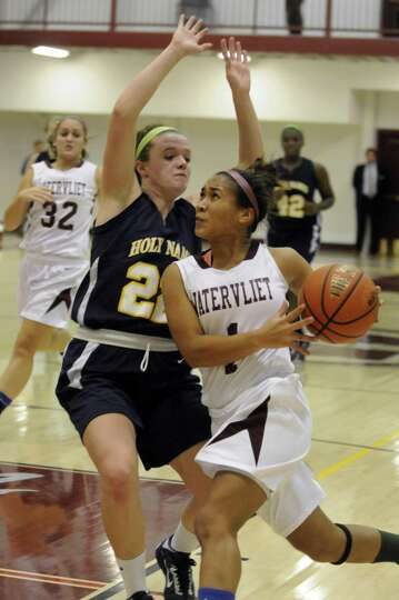 Watervliet's Ailayia Demand drives to the basket during their girl's high school basketball game aga