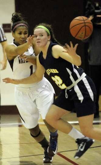 Watervliet's Ailayia Demand knocks the ball from Holy Names Sally O'Toole during their girl's high s