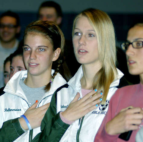 Particpating in the Pledge of Allegiance are Green Wave girls' soccer stalwarts, from left to right, Ali Rettenmeier, Julia Valentine and Sabrina Baxter, during the New Milford High School fall sports awards ceremony, Dec. 10, 2012 Photo: Norm Cummings