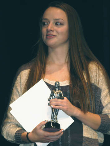 Jessica Noteware receives the Green Wave girls' cross country MVP trophy during the New Milford High School fall sports awards ceremony, Dec. 10, 2012 Photo: Norm Cummings