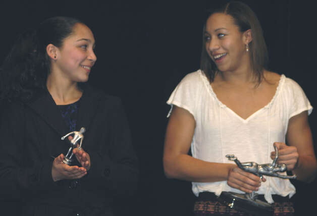 Green Wave girls' swimming MIP Briana Abrams, left, and MVP Kira Page share a light moment during the New Milford High School fall sports awards ceremony, Dec. 10, 2012 Photo: Norm Cummings