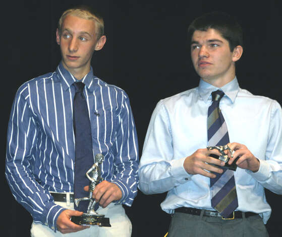 Green Wave boys' cross country MVP John Hansell, left, and MIP Louis Alhage hear words of praise from their coach Chris Bacich, during the New Milford High School fall sports awards ceremony, Dec. 10, 2012 Photo: Norm Cummings