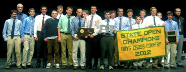 The Green Wave boys' cross country team proudly shows off its state open banner during the New Milford High School fall sports awards ceremony, Dec. 10, 2012 Photo: Norm Cummings